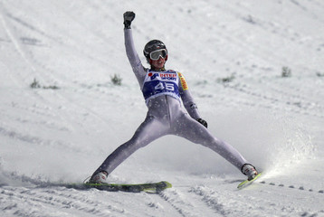 Poland's Kamil Stoch reacts after landing during the FIS World Cup Ski Jumping competition in Zakopane