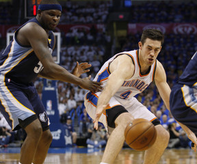Oklahoma City Thunder forward Nick Collison loses control of the ball against Memphis Grizzlies forward Zach Randolph in the first half of their Game 2 NBA Western Conference semi-final playoff basketball game in Oklahoma City.