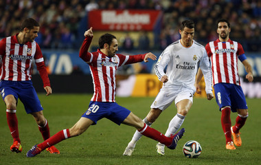 Atletico Madrid's Juanfran fights for the ball with Real Madrid's Ronaldo during their Spanish King's Cup semi-final second leg soccer match in Madrid