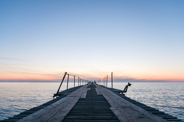 Vacation and Holiday concept - Wooden pier between sunset