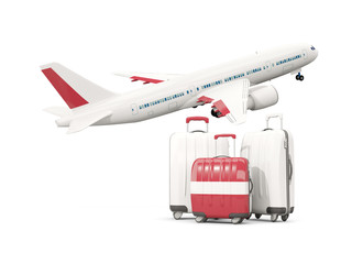 Luggage with flag of latvia. Three bags with airplane