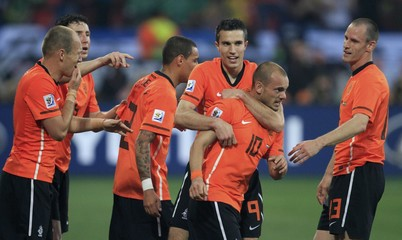 Netherlands' Wesley Sneijder celebrates his goal with team mates including Robin van Persie and Andre Ooijer  during their 2010 World Cup quarter-final soccer match against Brazil  in Port Elizabeth