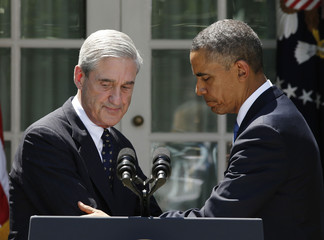 U.S. President Obama shakes hands with FBI Director Mueller after presenting Comey as his choice to replace Mueller during a Rose Garden announcement at the White House in Washington