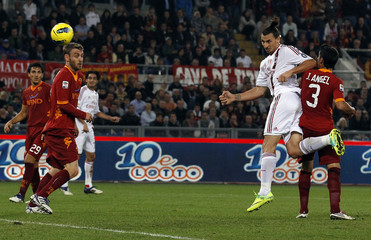 AC Milan's Ibrahimovic shoots and scores against AS Roma during their Serie A soccer match in Rome