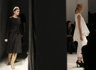 Models present creations by Ukrainian designer Marchi during Ukrainian Fashion Week in Kiev