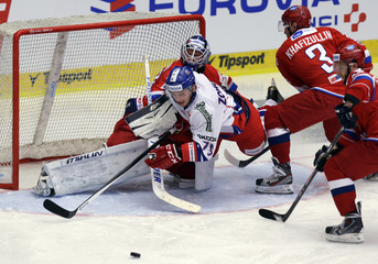 Czech Zohorna collides with Russia's Sharychenkov, Hafizullin and Mikhail Grigorev during their Euro Hockey Tour ice hockey match in Karlovy Vary