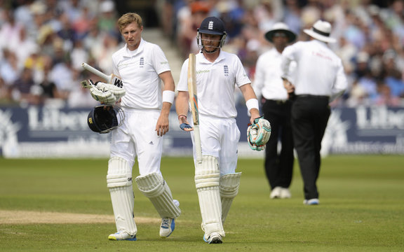 England's Ian Bell leaves the field after being dismissed as teammate Joe Root looks on during their first cricket test match against India at Trent Bridge cricket ground in Nottingham