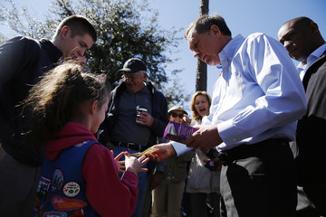 Kasich buys a box of Girl Scout cookies as he greets supporters after his rally in Bluffton, South Carolina