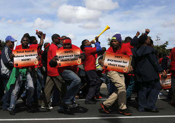 Members of the National Union of Metalworkers of South Africa (NUMSA) march during a strike in Cape Town