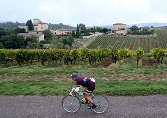 """A cyclist rides a vintage bicycle during the """"Eroica"""" cycling race of old bikes in Gaiole in Chianti"""