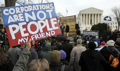 Demonstrators stage a protest near the U.S. Supreme Court building, on the anniversary of the Citizens United decision, in Washington