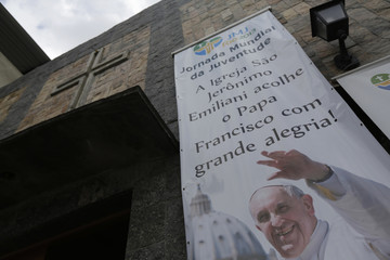A banner promoting World Youth Day is seen at the Chapel of Sao Jeronimo, where Pope Francis is expected to visit during his upcoming trip to Varginha slum in Manguinhos slums complex in Rio de Janeiro