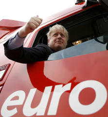"""London Mayor Boris Johnson sits in the cabin of a truck at an """"Out"""" campaign event, in favour of Britain leaving the European Union, at Europa Worldwide freight company in Dartford"""
