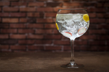 Aluminium Prints Cocktail Gin tonic on a wooden background