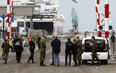 Dutch soldiers wait at the entrance of Turkey's Mediterranean port of Iskenderun as military vehicles carrying equipment for NATO patriot defence missiles disembark in Hatay province