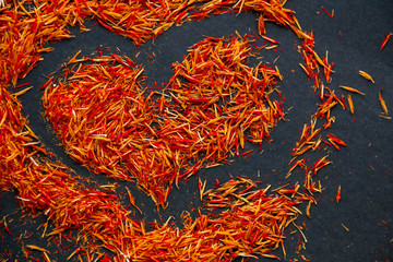 Exotic red hot spice, saffron for coloring food. background. isolated