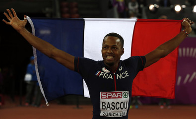 Bascou of France celebrates his third place in the men's 110 metres hurdles final during the European Athletics Championships at the Letzigrund Stadium in Zurich