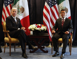 U.S. Vice President Biden and Pena Nieto, presidential candidate for the opposition Institutional Revolutionary Party pose in Mexico City