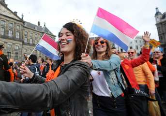 People celebrate the new King Willem-Alexander in Amsterdam's Dam Square