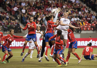 Buehler of the U.S. heads the ball against Rodriguez of Costa Rica during their CONCACAF Women's Olympic qualifying soccer match in Vancouver