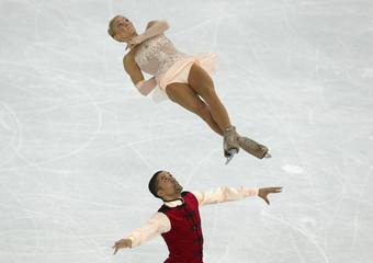 Aliona Savchenko and Robin Szolkowy during pairs free skating at the Sochi 2014 Winter Olympics