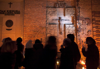 People visit the Powazki cemetery during All Saints day in Warsaw