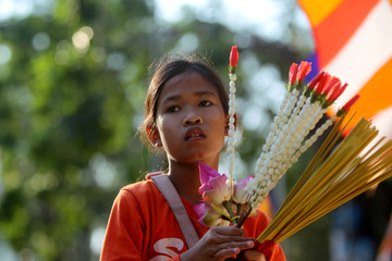 A girl takes part at the annual Makha Bucha Day which celebrates Buddha's teachings at the Oudong mountain in Kandal province