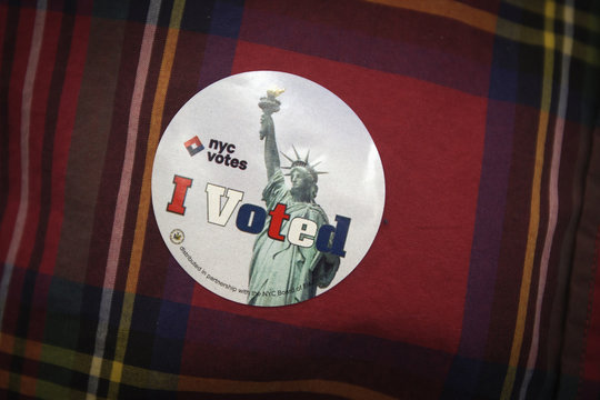 """A """"I Voted"""" sticker is pictured on a man's shirt inside a polling station in the Upper East Side of New York"""