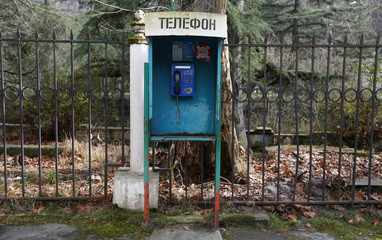 An old telephone booth is photographed in an old sanatorium in Sochi