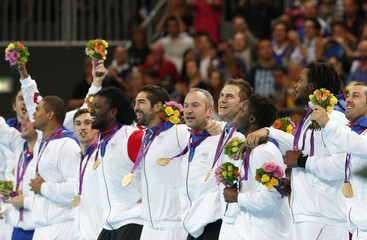 France's players celebrate with their gold medals at the men's handball victory ceremony during the London 2012 Olympic Games at the Basketball Arena