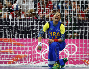 Brazil's goalkeeper Mayssa Pessoa reacts after conceding a goal by Russia in their women's handball Preliminaries Group A match at the Copper Box venue during the London 2012 Olympic Games
