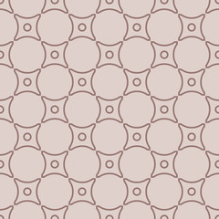 Geometric seamless pattern with circle elements. Brown textile or wallpaper background