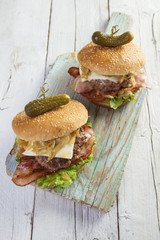 Deluxe gourmet burger on wooden table