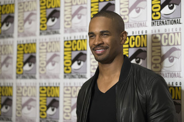 """Cast member Wayans Jr. poses at a press line for """"Let's Be Cops"""" during the 2014 Comic-Con International Convention in San Diego"""