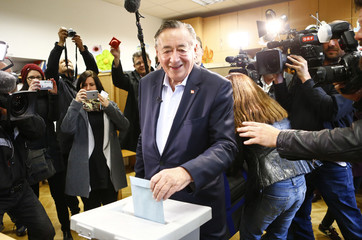 Presidential candidate Lugner casts his vote at a polling station in Vienna