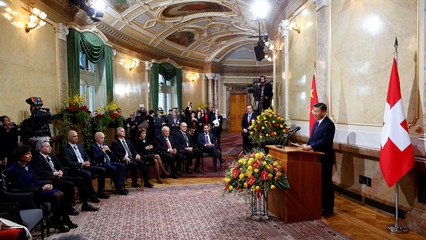 Swiss President Leuthard listens to a speech of Chinese President Xi Jinping at the Bundeshaus in Bern