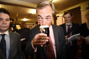 Farage enjoys a pint of beer as he celebrates after a hustings event at The Oddfellows Hall in Ramsgate