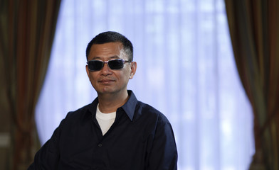 """Wong poses for a portrait while promoting his upcoming movie """"The Grandmaster"""" in Los Angeles"""