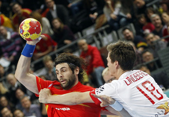 Spain's Garcia is challenged by Denmark's Lindberg during their Men's Handball World Championship final match in Barcelona