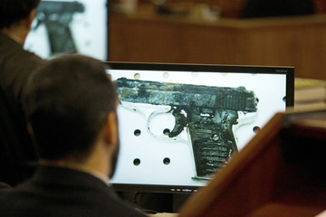 An image of a .22 caliber gun recovered from Landry Avenue is seen during the murder trial of former NFL player Aaron Hernandez in Fall River