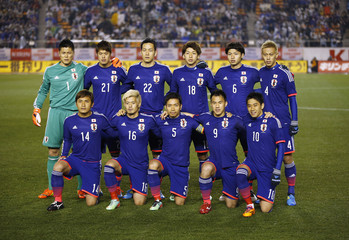 Japan's players pose for a team photo before their international friendly soccer match against New Zealand at the national stadium in Tokyo