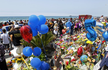 A memorial continues to grow in front of the water front home of ex-San Diego Chargers linebacker Junior Seau, who killed himself Wednesday with a shot to the chest, in Oceanside