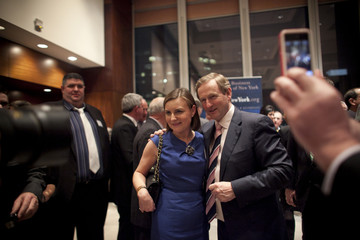 Ireland's Prime Minister Enda Kenny poses for photos with a woman at a meeting of the Irish Business Organization in New York