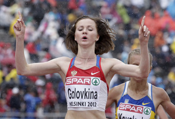 Golovkina of Russia reacts after winning the women's 5000 metres final at the European Athletics Championships in Helsinki