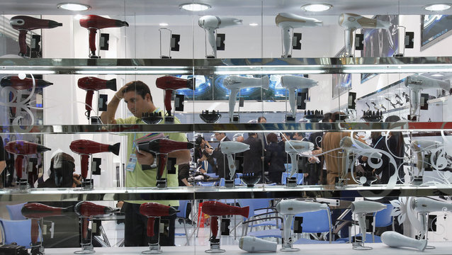 A visitor checks out hair dryers at the Canton Fair in Guangzhou