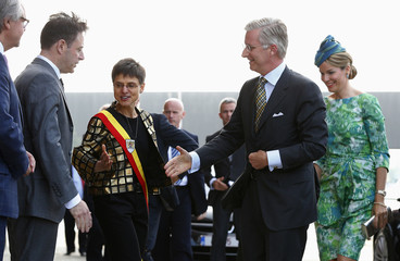 Belgium's King Philippe shakes hands with NVA party president and Mayor of Antwerp De Wever as he arrives at Mas Museum during the Joyous Entry of the royal couple in the province of Antwerp