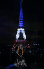 "Celine Dion performs ""Hymne ? l'amour"" in honor of the victims of the recent Paris attacks as an image of the Eiffel Tower is shown in the background during the 2015 American Music Awards in Los Angeles"
