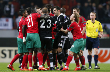 Players of Lokomotiv Moscow and Besiktas argue and scuffle during their Europa League group H soccer match in Moscow