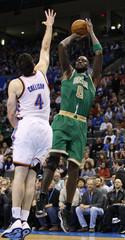 Celtics center Garnett shoots against  Thunder forward Collison in the second half of their NBA game in Oklahoma City.