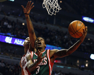 Bucks' Jennings goes to the basket against Bulls' Derrick Rose during their NBA basketball game in Chicago